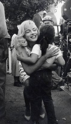 Marilyn Monroe.  This is one of my favorite shots, with Marilyn showing such a sweet smile and warmth toward this girl.