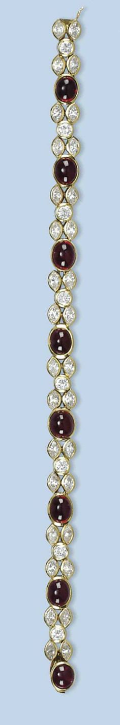 A RUBY AND DIAMOND BRACELET   Composed of oval cabochon ruby links with navette and brilliant-cut diamond set connections, 18.5 cm long