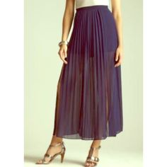 2x Host PickNavy Maxi Skirt The perfect Maxi. It's navy blue with pleating in the front and identical pleats in the back. Two slits on the front on both legs. It's 100% polyester with a shell underneath. The skirt feels like chiffon to me. I originally purchased at a boutique on Newbury St. and wore once on vacation. It's in perfect condition! Costa Blanca Skirts Maxi