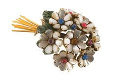 An Iradj Moini goldtone floral brooch, set with : Lot 1287