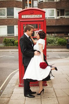 I like her dress length, black petticoat, and the telephone booth.