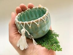 This is a beautiful handmade ceramic bowl with white stitching around the top. Perfect for jewelry, trinkets or display. A unique gift that will last forever. Great care was taken to create the one of a kind wonder. How its made: First it was thinly crafted on the wheel. Next small holes