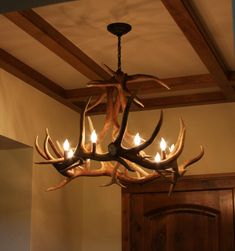 Sooper cool idea I got a few years ago. You take a faux antler chandelier, pait it blue and sprinkle black glittler on it! It makes for some awesome lighting. Antler Lights, Antler Chandelier, Rustic Chandelier, Bar Lighting, Chandelier Lighting, Tiffany Chandelier, Cabin Chic, Wrought Iron Chandeliers, Western Decor