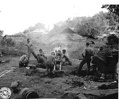 WWII Field artillery firing 75 mm Pack Howitzer from Namhkam on Burma Road. Photographer Zimmerman