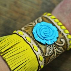 The Reno   Wild Bleu Hand cut, tooled, & painted leather artwork,Turquoise rosette, Hand cut fringe,Silver button accents Buck stitched