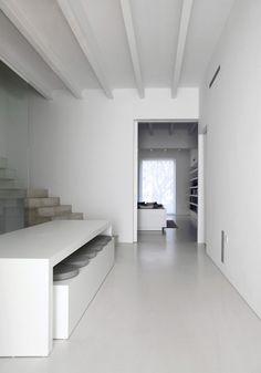 White concrete floor. I do not like simple decor, but I am loving this.