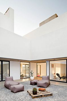"Minimalist Architecture: ""Villa Extramuros...living spaces are however well protected retaining the visitor's privacy without compromising the diffused, natural lighting..."""