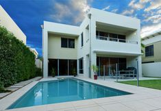 Contemporary home with landscaped swimming pool area