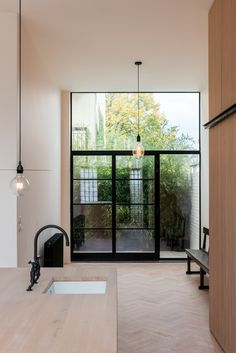 Located at the end ofa cul-de-sac in the Forest Hill neighborhood of southeast London, the Imperial Club is a new-build complex consisting of three houses