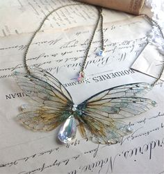 Beautiful delicate faerie winged necklace by UndertheIvy2.  Look how real they look!