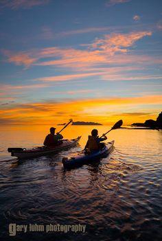 Sea kayakers paddle toward sunrise, Los Gatos, Sea of Cortez, Baja, Mexico. #kayak #kayaker #kayaking