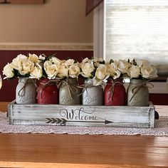 Create that perfect farmhouse theme with a gorgeous mason jar centerpiece! This would go perfect on an entryway table or a centerpiece for your kitchen table. Mason Jar Projects, Mason Jar Crafts, Mason Jar Diy, Diy Jars, Kitchen Centerpiece, Mason Jar Centerpieces, Centerpiece Ideas, Mason Jar Kitchen Decor, Kitchen Ideas