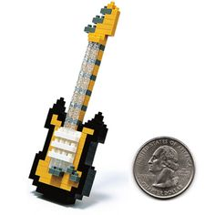 "Create a 3D Nanoblock Electric Guitar!  Nanoblocks are a micro-sized building block system with the smallest piece being a mere 1/8"" x 1/8"" x 3/16""."