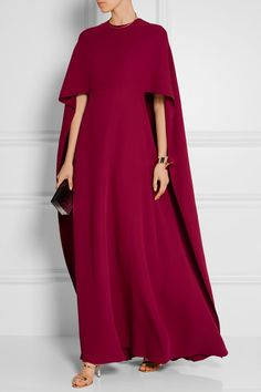 "VALENTINO Cape-back silk-crepe gown$7,690 | ""Timeless modernity"" is how Valentino's Creative Directors Maria Grazia Chiuri and Pierpaolo Piccioli describe their approach to design. Embodying this sentiment, this claret gown is beautifully cut from tactile crepe and unlined for lightness. It turns to reveal a cascading cape back that elegantly sweeps the floor. Complement the bold hue with gold jewelry."