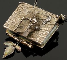 From the the Book & Locket Collection, Elemental Adornments. Fine art silver jewelry by Christi Anderson (Jewelry Designer. Marana, Arizona). Wow. Nice!
