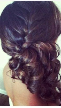 French braid to a side curly ponytail.
