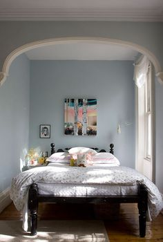 a light blue paint cheers up a smaller space. Sarah Bedford/Alan Hill sneak peek on #designsponge.