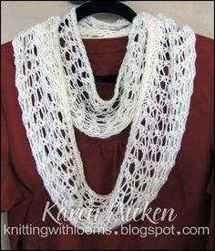 Knitting With Looms, finished lacy infinity scarf. The steam blocking really opened up the lacy stitch!