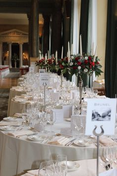 Romantic candelabra design with red tulips and white tulips at Woburn sculpture gallery