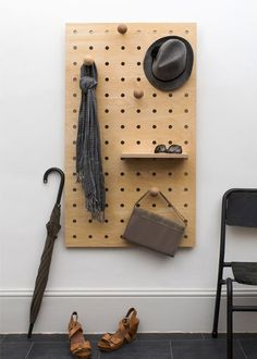 Another great way to use the plywood pegboard is in an entry hall - or make a…