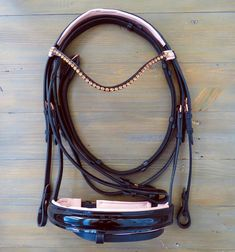 Black leather bridle with patent nose band and rose gold accents. This bridle comes as a crank noseband, with flash attachment and flash. You don't even need to buy a fancy brow band because this bridle is adorned with a black and rose leather br. Dressage Bridle, Horse Bridle, Horse Gear, Andalusian Horse, Friesian Horse, Arabian Horses, Baby Horses, Cute Horses, Draft Horses