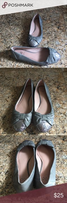 Vince Camuto gray bow flats Adorable Vince Camuto gray flats with big leather gray bow and silver glitter toe detail. Size is not indicated but it is a size 7 woman. Matirial isn't indicated but it looks like Devine l genuine leather upper and lining. Small stains on sides pictured. Very cute and comfortable! Vince Camuto Shoes Flats & Loafers