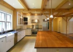 Kinda sterile looking, but like the idea of beams and layout of kitchen  Farmhouse kitchen - contemporary - kitchen - burlington - Perkins Smith Design Build