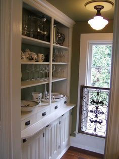 Always open. Remove old-fashioned and out-of-date cabinet doors for this fresh look. Expose all your organized glassware and dishware with an open shelving concept to modernize the traditional butler's pantry.