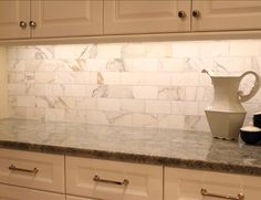 Marble Kitchen Backsplash. The backplash on the side walls of the kitchen are calcutta gold marble 3x6 in a running bond pattern. #Marble #Kitchen #Backsplash