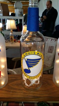 Upcycled lighted wine bottle with St Louis Blues decorations. A standard strand of 20 white lights are included. Great gift for your sports fan!!!!!