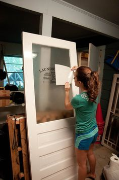 She DIY'd this, so I bet I could remove our laundry room and DIY the whole interior as glass instead of just the top half