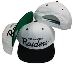 Los Angeles Raiders White/Black Two Tone Plastic Snapback Adjustable Plastic Snap Back Hat / Cap by Reebok. $18.96. All Brand New.. Guaranteed 100% Authentic Product Made by Reebok.. Officially Licensed By the League.. NFL LA Raiders White 2 Tone Snapback Vintage Old School Black Cap . From the Vintage NFL Collection. . Size is a One Size Snap Back. . Retro Old School men's Original NFL 2 Tone custom Snapback cap. . Custom 2 Tone color cap. . Original Vintage Snapback Ca...