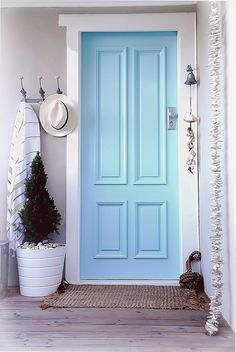 Decorating a entrance / front door for a coastal nautical beachy vibe - casual style blue front door with coastal accents & nautical style abeachcottage.com Sydney Australia
