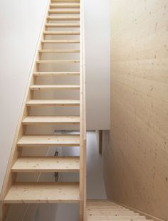 Stark hallways and stairwells get a dose of warmth via natural wood stairs. For more warm wood interiors, see our post 10 Favorites: Warm Wood from Members Stairs And Staircase, Loft Stairs, Modern Staircase, House Stairs, Staircase Ideas, Multifunctional Furniture, Minimalist Apartment, Wooden Stairs, Interior Stairs