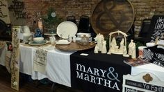 Mary & Martha products on display at a vendor event. Loving God, loving others.