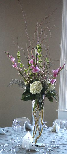 Tall centerpiece inspiration, love the curly willow with different flowers