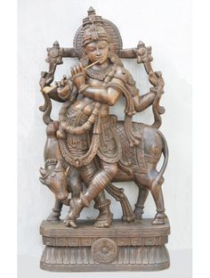 Wooden Krishna Playing Flute With Cow,Wax Brown wooden carvings purchase,krishna with flute and cow Rain Clouds, Wood Wall Decor, Peacock Feathers, Lord Krishna, Flute, Cow, Lion Sculpture, Carving, Symbols
