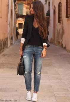 Everyone has a reliable black blazer for work or occasions the converse and bf jeans really make it look casual love it!