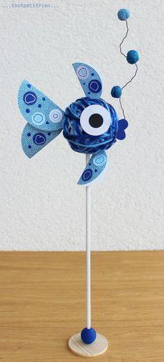Poisson tout rond! Une boule de polystyrène entourée de laine. www.toutpetitrien.ch / fleurysylvie #bricolage #enfant