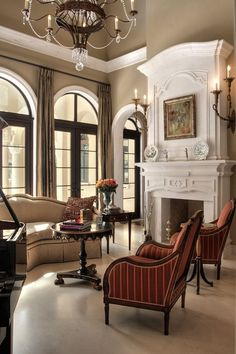 Traditional Living Room with High ceiling, limestone floors, Chandelier, Ethan Allen - Chinoiserie Accent Table, Wall sconce