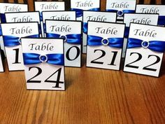 <p>The 24 table numbers were made for my daughters wedding. The ribbon is royal blue and the paper is white with a gold shimmer.</p>