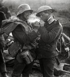 This is amazing! British and German soldiers exchanging cigarettes and other gifts during the Christmas Truce on December 24-25, 1914.