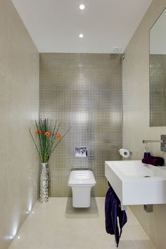 Powder Room Contemporary Cantilevered Sink decorative ideas with downstairs toilet flowers metallic tile mirror recessed lighting tile wall under sink towel