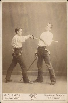 ca. 1880, [cabinet card, portrait of a man winning a mock sword fight with the other], O. C. Smith  via Christopher Wahren Fine Photographs, ...
