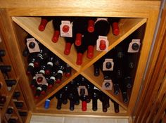 X Bins Custom Wine Racks. These are Double Deep for more storage Capacity. More pictures of the wine cellar can be found here - http://www.winecellarspec.com/custom-wine-cellars-dallas-texas-dann-wine-closet/#. Wine Cellar Specialists  4421 Cedar Elm Circle Richardson, TX 75082  Toll Free: 866-646-7089  Texas Office: 972-454-0480