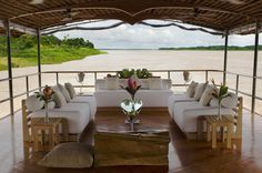 Relax with a refreshing drink while enjoying this amazing view of the Amazon on board the Delfin I.