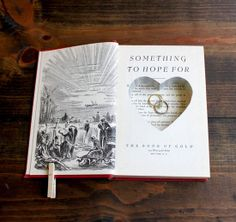 Book Ring Pillow case  Instead of a ring pillow, hollow out a book to keep your wedding rings