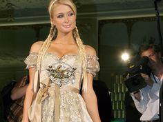 Paris Hilton at Oktoberfest wearing a Golden Dirndl by German designer Lola Paltinger. the perfect bra - order here > http://www.sariana.com/shop/product_info.php?info=p294_marry-heidi-push-up.html #dirndl #bra #perfectbra #sariana