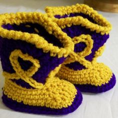 Check out these cute purple and gold crochet baby booties from Barbs Gallery of Art, only $16.00 on Amazon. Find them at http://www.artfire.com/ext/shop/product_view/BarbsGalleryofArt/4494870/Baby_Cowboy_Boots-Purple_and_Gold_Crochet_Shoes-LSU_Colors/Clothing/Babies_Toddlers/Shoes