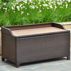 Back patio / deck storage. Barcelona Resin Wicker Storage Deck box with Faux Wood Top $392